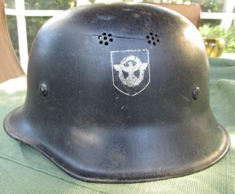 Late war M34 DD police helmet.