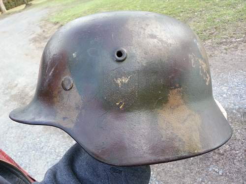 Interesting Normandy Camo lid ....unusual and backwards swastika paint applied.....G.I. or kid in the 50's , lol