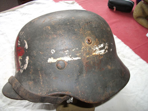 Is this a real WWII helmet, with red cross?