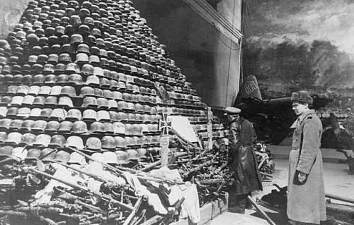 Dumped, discarded German helmets.