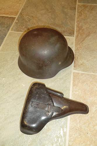 Army helmet and pistol belonging to the same soldier.