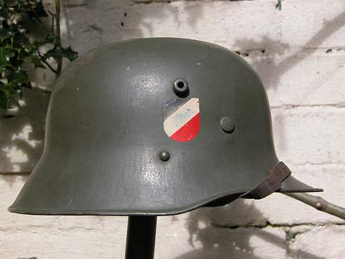 Combat helmets with round bottom national shields.