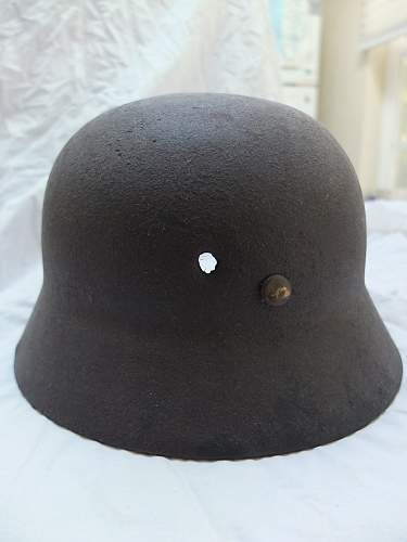 Ever seen a Nazi Helmet w/ bullet hole?
