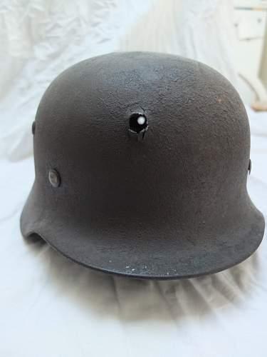 Ever seen a Nazi Helmet w/ bullet hole?
