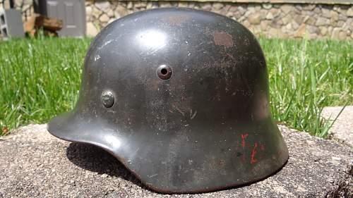 The Sun and German Helmets
