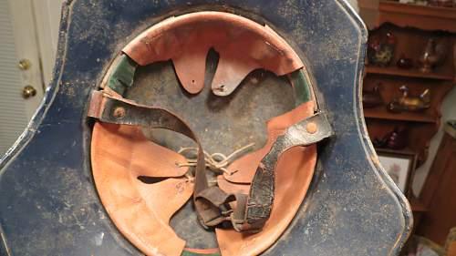 One piece Luftschutz gladiator helmet.