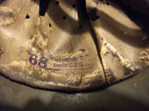 German M40 Helmet , i fear the worst :(.