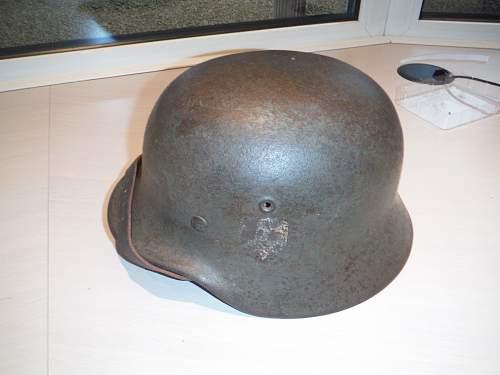 M35 wehrmacht helmet with fake liner i think?