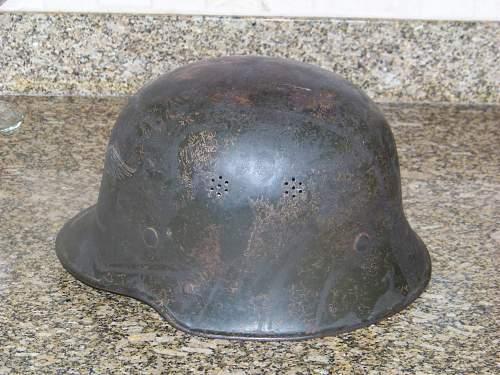 Dark green M34 luftschutz helmet.