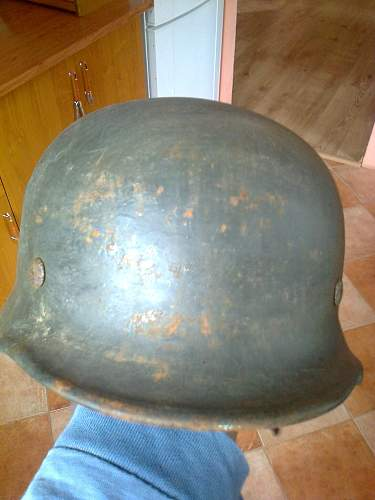 Is this helmet really an authentic post war painted Normandy camo scheme helmet?