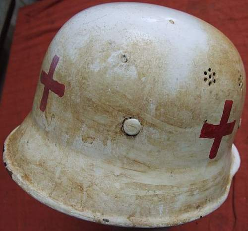 Is tis  original  german air raid home service helmet for the red cross