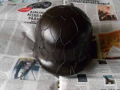 Is this an original Heer helmet with chicken wire?