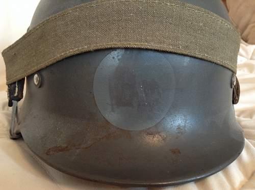 Two German helmets, M-35 and M-42.