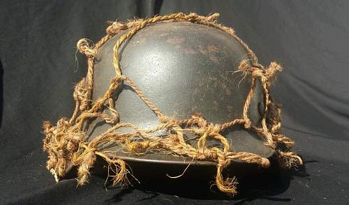 German helmet with camo netting..whats your thoughts