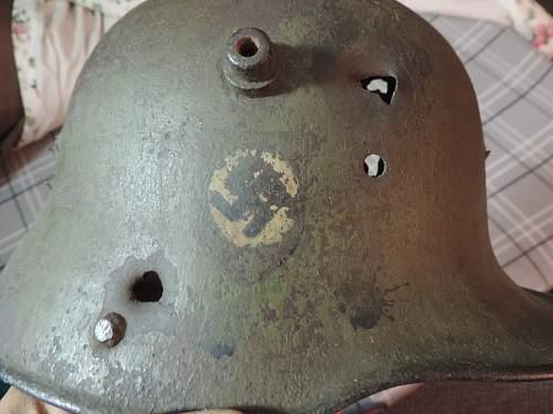 WW1 battle damaged German helmet with WW2 Nazi decals
