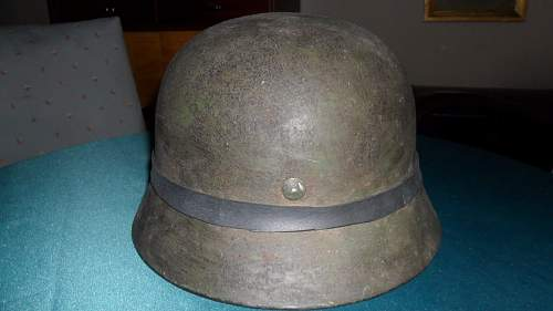 German m35  helmet on auction with camo band, need thoughts