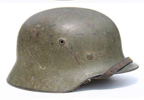 Click image for larger version.  Name:WWII-M40-Q66-German-Camo-Helmets-H2192.jpg Views:417 Size:166.8 KB ID:864469