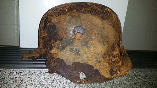 3 helmets. 2xM18 and 1xM17. Reused During ww2??