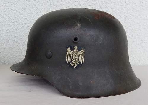 Three german helmets