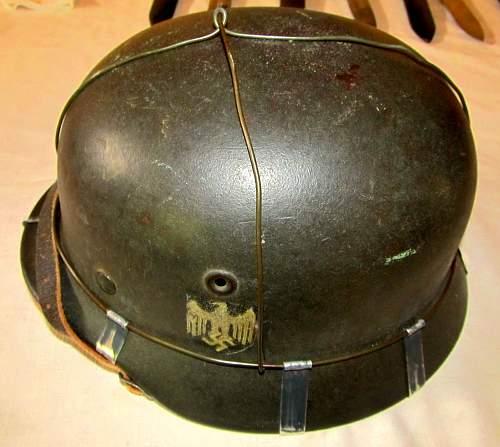 Partial faint remains of bluish/purple ink stamp inside top of M40 helmet