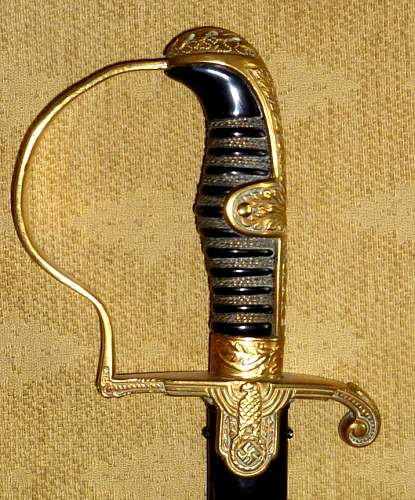 WH sword with left rotated svastika. Helps needed