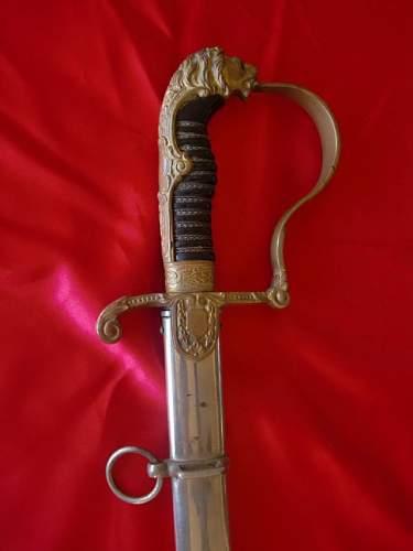 Lionhead Sword w/Nickel scabbard ?