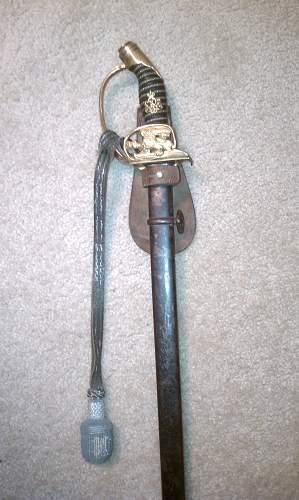 Sword hanger and Portepee ID Help Needed