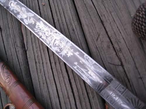 Orange gripped Kriegsmarine sword...