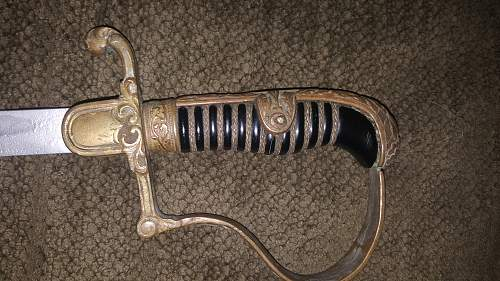Does anyone have any idea what sword this is?  I can't seem to find it anywhere online