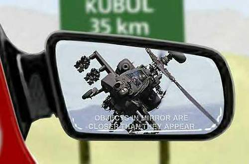 Click image for larger version.  Name:apache chopper in rear view mirror.jpg Views:39 Size:26.1 KB ID:265400