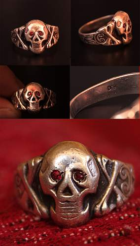 Skull ring with red eyes.