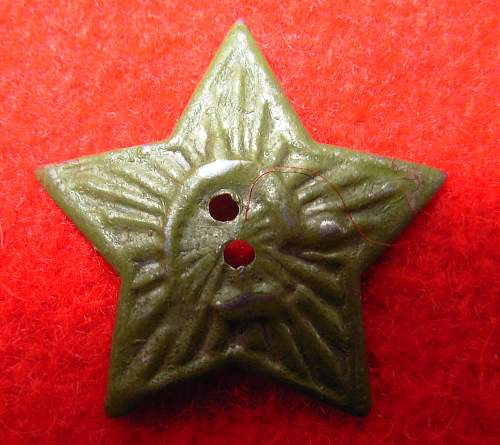 Green Russian cap badge