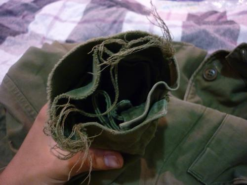 Is it ok to mend tears or the tag on an M-43 jacket?