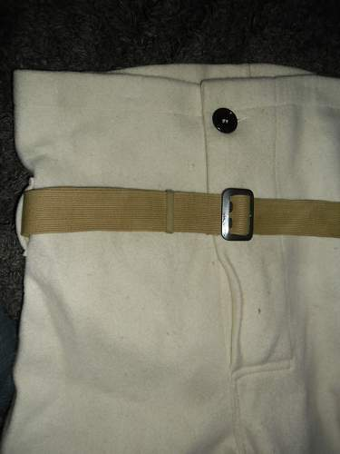 Belt that came with white mystery pants could it hole a clue as to what they are or where they originate ?