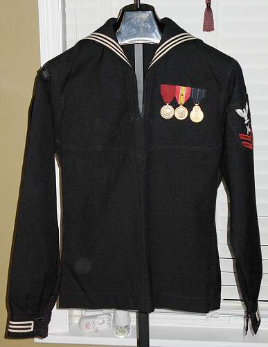 I need help identifying the era of two Navy items...