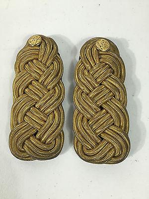 Mess dress gold braid shoulder boards.