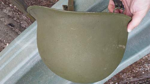 Need help identifiying vietnam era M1 helmet with odd chinstrap markings