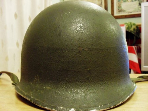 Fixed bail M-1 helmet, looks to have a gray painted band ?