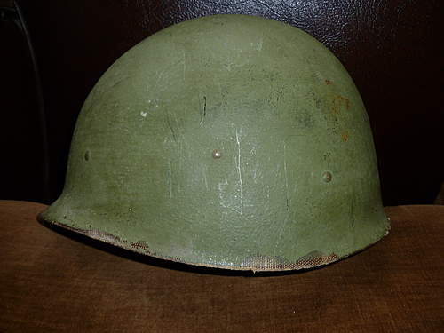 Grey M1 helmet.