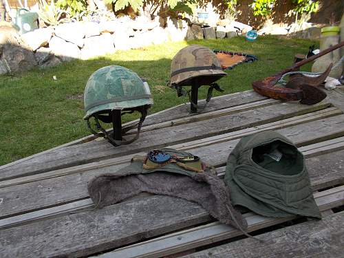 Top shelf example of a Vietnam period M1 Helmet.