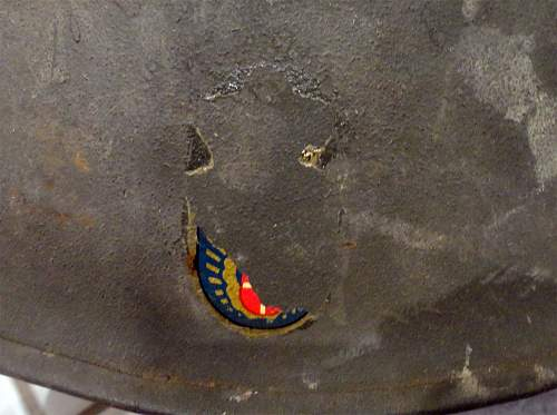 M1 helmet with a mysterious insignia