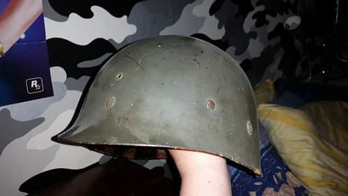 M1 helmet liner with initials.