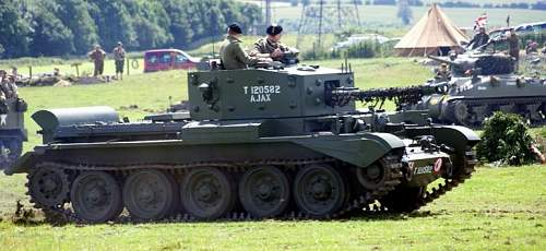 """Photos of a WW2 Canadian Tank pushing a """"Snake"""""""