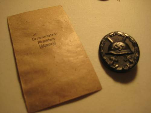 German Black wound badge with issue pack.