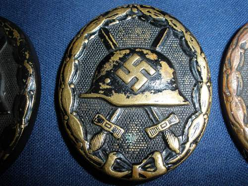 3 black wound badges