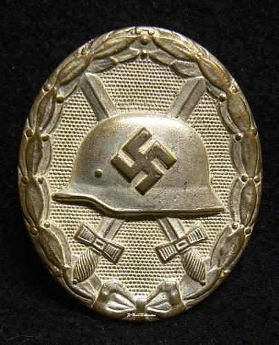 Combat worn L/53 silver well...?