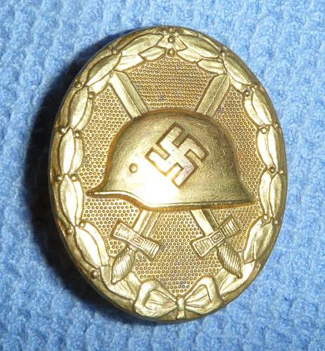 Click image for larger version.  Name:Wound badge gold.JPG Views:163 Size:236.4 KB ID:195188