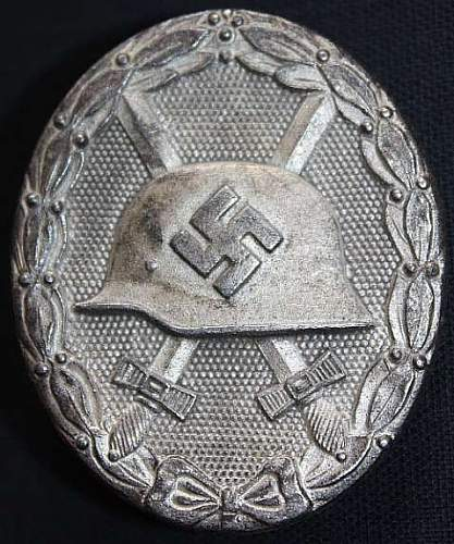 """Verwundetenabzeichen """"65"""" and a Allgemeines Sturmabzeichen R.S"""