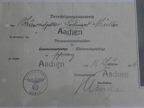 verwundentenabzeichen marine 1936 with paper and picture