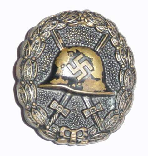 Click image for larger version.  Name:Spanish pattern wound badge in black..JPG Views:1094 Size:44.0 KB ID:4011